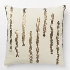 """Sequin Fern Pillow Cover -Beaded beauty. Hand-beaded by Indian artisans in a botanical pattern, the pure cotton Sequin Fern Pillow Cover is a simple way to bring a subtle splash of nature-inspired pattern and shine to a space.   18""""sq. 100% cotton in Ivory. Hand-beaded. Accommodates a 18""""sq."""