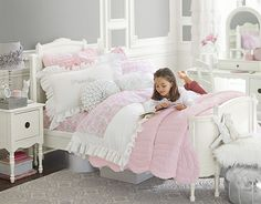 I love the Pottery Barn Kids Ruffle Collection on potterybarnkids.com. doing Idgie's bedroom in pale pink and light gray