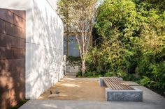 """Named """"Hide Out"""" the beautiful contemporary residence of Taiwanese artist James Jean was redesigned by Dan Brunn Architecture, featuring a large metal pivot door, wooden. Pivot Doors, Frank Gehry, Interior Garden, Outdoor Areas, Garden Landscaping, Outdoor Living, Sidewalk, Exterior, Landscape"""