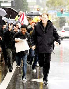 Conan O'Brien running from the rain or the mob of fans?