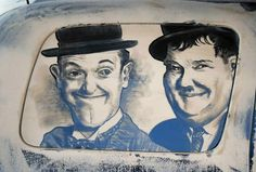 Art on a dirty car windshield.