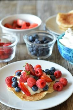 Lightened up Berry Shortcake Tostadas. Baked cinnamon-sugar corn tortillas, lightly sweetened Greek yogurt and whipped cream and fresh berries!   mountainmamacooks.com #TacoTuesday #glutenfree