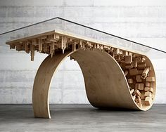 stelios mousarris is a cyprus based furniture designer whose brand, mousarris, is best known for creating surreal and sculptural functional art objects. his most recognized work is the 'wave city' collection, which plays with the manipulation of architectural elements to form a coffee and dining table.