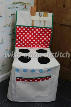 Awesome play oven which is a chair cover. Wish upon a stitch on facebook