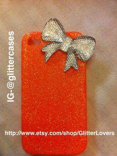 Handmade neon orange fine glitter iphone 4/4s case with 3D bling resin bow. $18.00, via Etsy.