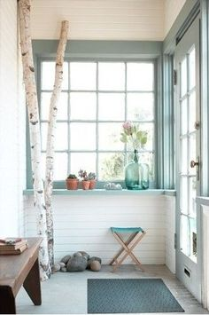 I like the idea of painting our sunroom walls white and adding some teal color with the trim.