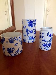from glass jars to elegant china using White Rustoleum Painters Touch Ultra spray paint + blue acrylic Painting Glass Jars, Sand Painting, Bottle Vase, Glass Bottles, Wine Bottles, Starbucks Frappuccino Bottles, Barn Quilts For Sale, Easy Diy Candy, Pottery Barn Hacks