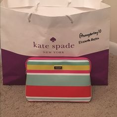 "Kate Spade iPad Mini Zip Sleeve Authentic Kate Spade colorful ""Beach Stripe""!iPad Mini padded sleeve.  Has been used and cleaned. There is one small spot in the 3rd picture. Measurements: approx. 8.5L x 6H  No trades. kate spade Accessories Laptop Cases"