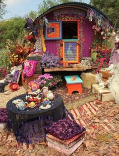 Oh to have a gypsy caravan in the backyard. Garden whimsy.