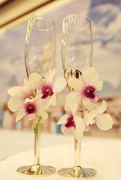 Great idea with orchids on the champagne flutes...repinned by The Rose Bud Flowers in Chickasaw, Alabama