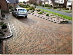 This unique driveway repair is seriously a notable design approach. Front Driveway Ideas, Garden Ideas Driveway, Block Paving Driveway, Brick Driveway, Backyard Walkway, Brick Pathway, Driveway Design, Driveway Landscaping, Brick Pavers