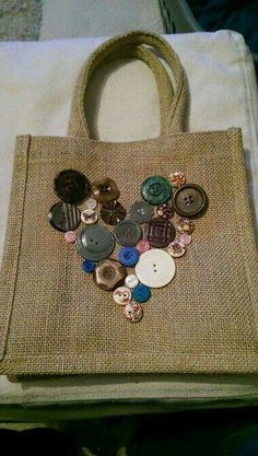 Decorated a Hessian bag with old buttons to make a pretty lunch bag for work. Hessian Bags, Jute Bags, Diy Tote Bag, Burlap Crafts, Patchwork Bags, Denim Bag, Fabric Bags, Button Crafts, Handmade Bags