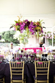Modern kiri wood boxes held varied floral compositions with dahlias, orchids, and coxcomb while scabiosa pods and hanging amaranthus finished the look. Photos: Luna Photo. Wedding Coordinator: Thomas Bui Lifestyle. Florals: Adorations Botanical Artistry.