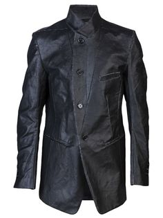 Over-sized jacket in graphite black from Ann Demeulemeester. This long sleeve jacket features notched lapels, front button fastening and two pockets. Has lining and two slits in the back center.