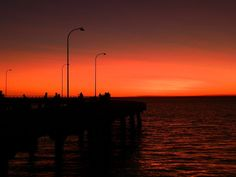 This #Sunset at Derby, Western #Australia, comes with all the props: a Jetty, lots of people, street lamps, and the biggest tide in #Australia!