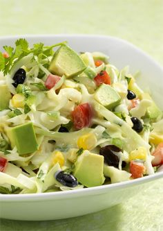 Corn, black beans, cilantro and lime juice lend a bit of Southwest flavor to this salad of cabbage, sweet onion and Marzetti Original Slaw Dressing. Salad Recipes Video, Slaw Recipes, Entree Recipes, Healthy Salad Recipes, Veggie Recipes, Whole Food Recipes, Cooking Recipes, Healthy Dishes, Healthy Eating