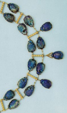 An Egyptian Revival favrile glass scarab and gold necklace by Tiffany & Co. around 1911. Source: The Jewelry and Enamels of Louis Comfort Tiffany by Janet Zapata. #LouisComfortTiffany #EgyptianRevival #necklace