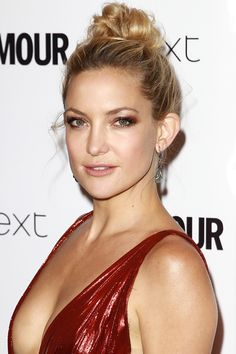 Who: Kate Hudson What: Brick Red Eyeshadow How-To: Matching your makeup to your dress isn't daring—unless your dress happens to be red and you're playing up your eyes. The actress pulled off the move by choosing a darker, burnt shade of red over a pink-toned one and highlighting around it with champagne shimmer. Editor's Pick: Almay Intense i-Color Smoky-i Eyeshadow for Green Eyes, $3.50, target.com.   - HarpersBAZAAR.com