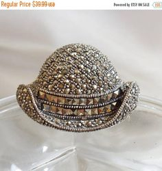 This #vintage sterling silver marcasite bowler hat brooch is just beautiful! It features a sterling silver bowler style hat with an upturned curled brim covered with round... #ecochic #etsy #jewelry #jewellery