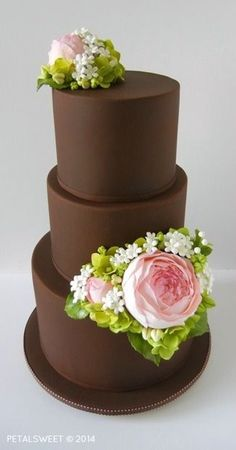 Designed and created for the San Diego Cake Show March 8 - 9, 2014. Chocolate fondant with pink sugar roses and buds, hydrangea and filler flowers...by Petalsweet.