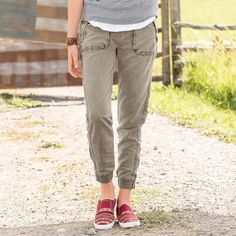 """OFF-DUTY PANTS--These sumptuously soft pants pair well with flats or heels. A lustrous finish complements the utility of front zip slant pockets, back zip pockets, drawstring waist and banded zip cuffs. Rayon/polyester. Machine wash. Imported. Sizes 26 to 31. 29"""" inseam."""