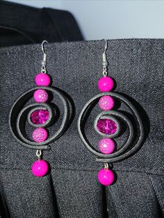 Pink leather earrings.