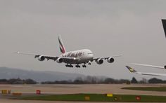 Video shows the moment strong crosswinds make landing difficult for this   Airbus A380 plane