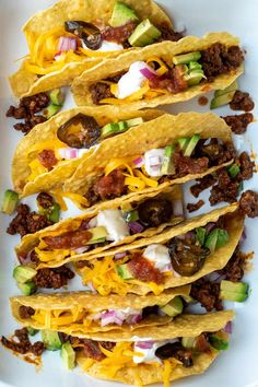 Classic family friendly tacos with easy homemade ground beef taco filling, comes together in about half an hour for a delicious weeknight dinner. #thehungrybluebird #classicbeeftacos #groundbeeftacos #tacotuesday #homemadetacomeat #beeftacofilling #fromscratch #weeknightdinners #easyrecipe #comfortfood Homemade Tortilla Chips, Homemade Enchiladas, Homemade Tacos, Ground Turkey Enchiladas, Ground Beef Tacos, Beef Taco Seasoning, Ground Sirloin, Taco Fillings, Refried Beans