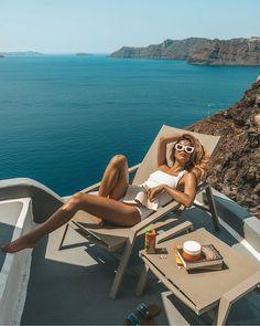 Fitness big breasted woman enjoying the sun at a boat in sexy bikini bra and thong swimwear.
