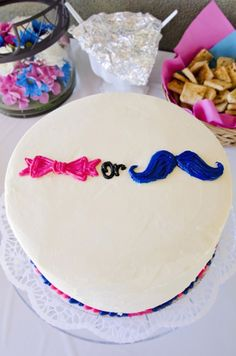 Bow and Beau? Icing inside reveals baby's gender. {www.prettymyparty.com} #gender #reveal #party #cake
