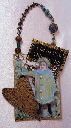 ATC - love the dimension and the beaded hanger
