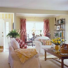 LIVING ROOM White slip covered couch and chair yellow painted walls striped painted walls in entryway red and white checked ring top curtains checked pillows pine coffee table floral arrangenment of yellow rose bakers rack with yellow and French Country Living Room, French Country Bedrooms, Living Room White, French Country House, White Rooms, French Country Decorating, Home And Living, Living Rooms, French Cottage