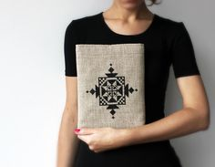 LOVING this ipad case....just love the cross stitch. Totally doable. Embroidered iPad sleeve iPad case Tribal ethnic black ornament. via Etsy.