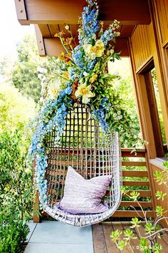 The most perfect reading nook in the world. Floral styling byMaurice of Bloom & Plume.