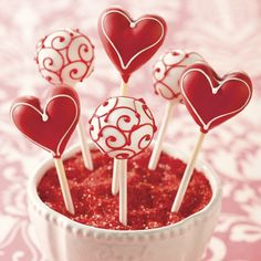 these cake 'lollypops' will make Valentine's Day that much more special. You'll get equal amounts of traditional hearts as well as beautifully decorated balls. Made from moist, chocolate cake, for a treat that nobody will be able to resist. Valentine Desserts, Valentines Day Chocolates, Valentines Day Cakes, Valentine Chocolate, Valentine Cookies, Valentines Cakepops, Cake Pops, Chocolate Day, Chocolate Treats