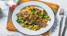 Cajun Spiced Bass Recipe | HelloFresh Cook Skins, Hello Fresh Recipes, Lemon Potatoes, Green Bowl, Sea Bass, Dressing Recipe, Everyday Food, Dinner Tonight, Tray Bakes