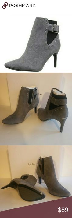 """🆕Calvin Klein Studded Suede Booties These fashion forward booties allow you to dress to impress day or night! Zip into these studded booties with anything from jeans to  your favorite flirty dress. Contrast with stud embellishments and buckle detail at back. Heel"""" 3"""". Color: gray. According to the manufacturer, the fit runs true to size. Calvin Klein Shoes Heeled Boots"""