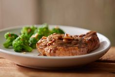 Pork Chop Marsala - Wood-grilled and topped with mushrooms and our Lombardo Marsala wine sauce