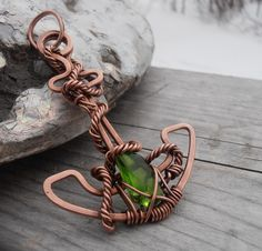 ...very high green deficiency at the end of long winter..:) Custom order anchor pendant, made out of copper wire and green sea glass from Cape Breton...www.facebook.com/petra.leblanc