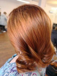 Golden copper wavy hair