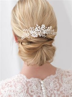 Shop best selling bridal accessories! Wedding headpiece features ivory enamel flowers that sparkle with rhinestone accents.