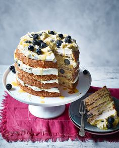 The lemon cake to end all lemon cakes – we've layered sponge with sweet-tart lemon curd mousse, blueberries and white chocolate to make a truly show-stopping dessert.