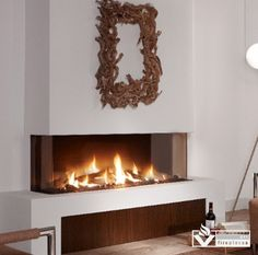 "The Trisore 140 is a 3 sided or ""Bay"" style fireplace with a frameless design. This very modern, fresh look comes from the Netherlands. Simplicity in construction simplifies installation and maintenance. Simplicity in use guarantees a cozy and warm atmosphere in the home with literally just one push of a button. Finally, simplicity in design results in designs that do full justice to the unique beauty of the fire."