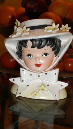Del Mar Opening Day Relpo Child Head Vase This is one of the most desirable child head vases by Relpo. She is a cheery-faced Dark haired girl. She has