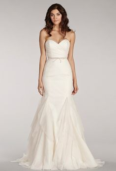 Brides: Blush by Hayley Paige. Ivory fit to flare English net gown with sweetheart ruched bodice, lush textured skirt, beaded bow belt at waist and chapel train.