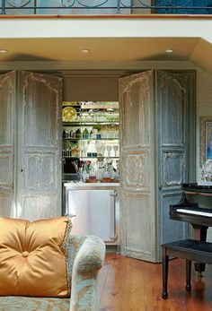 "Sela Ward's Stylish Bel Air Home With a Southern Soul - Traditional Home. Living room bar is hidden behind reclaimed doors. What a great way to hide a bar ""look"" that doesn't go with your décor. Style At Home, Bel Air, Traditional Home Magazine, Reclaimed Doors, Wooden Doors, Repurposed Doors, Home Decoracion, Entry Way Design, Antique Doors"