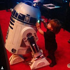 Pin for Later: Jaime, Kourtney, and Kate Shared the Cutest Pictures of Their Kids This Week!  James Knight was fascinated with R2-D2 (and who wouldn't be?).