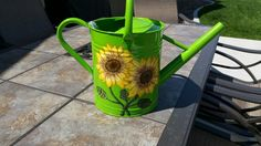 A friend of mine said she has always wanted a watering can with Sunflowers on it and asked if i could paint some on it for her.  I said i have never done that before but i will give it a try.