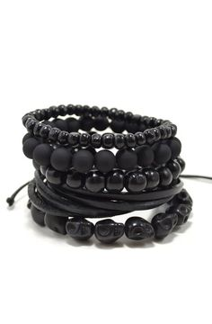 Product Details - 5 Piece Set - Includes 10mm and 6mm bamboo wood, 10mm resin beads, 13mm stone skulls, and a pull-closure leather bracelet Color: Black Materia