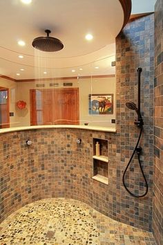 Open tiled shower with rainhead shower fixture and spray rail in bathroom remodel in Virginia